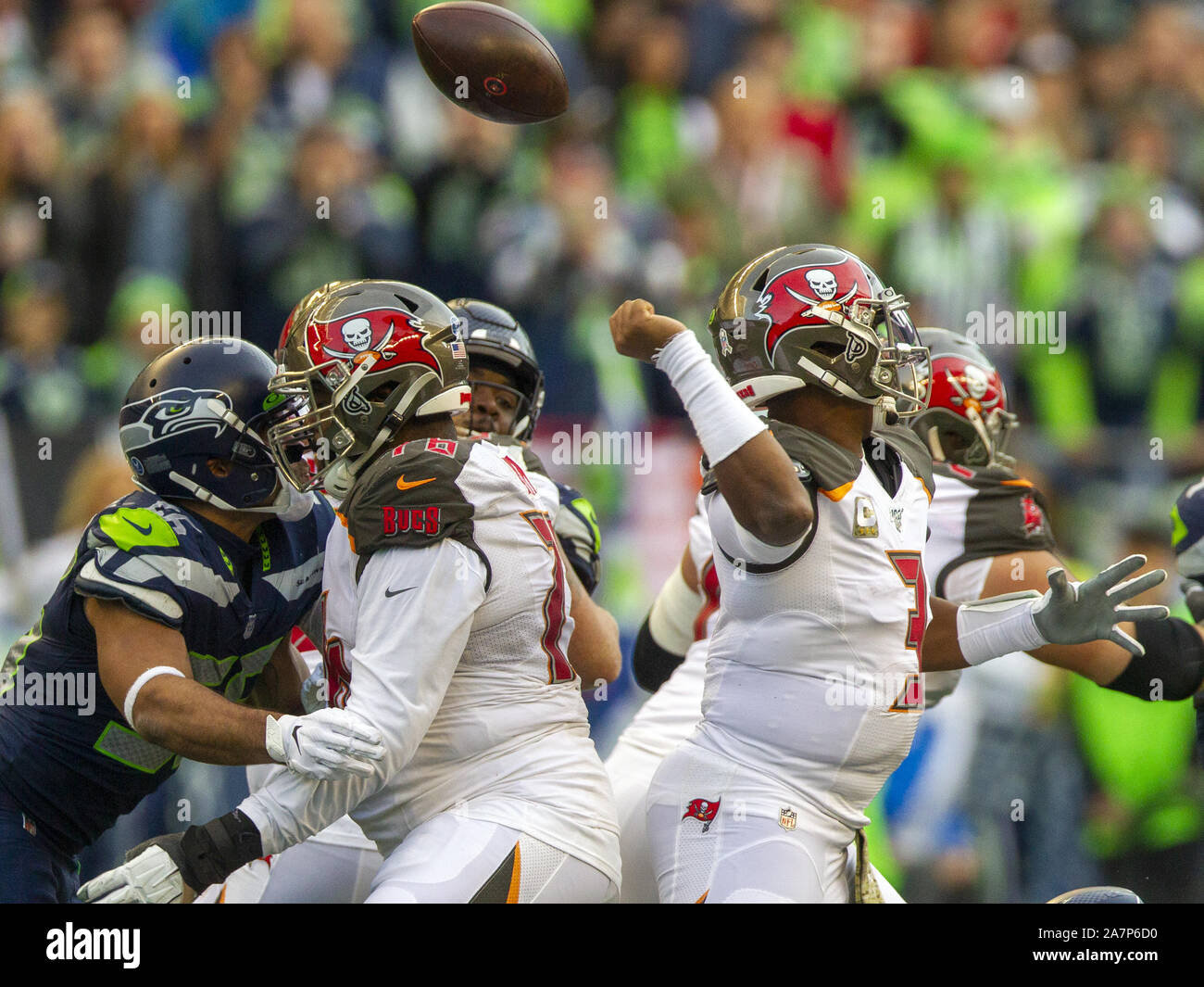 Seattle, United States. 03rd Nov, 2019. Tampa Bay Buccaneers quarterback Jameis Winston (3) looses the ball while trying to pass against the Seattle Seahawks during the fourth quarter at CenturyLink Field on Sunday, November 3, 2019 in Seattle, Washington. Seattle Seahawks defensive end Rasheem Green (98) caught the ball. In mid-air and returned it to the Tampa Bay 15-yard line. The Seahawks beat the Buccaneers 40-34 in overtime. Jim Bryant Photo/UPI Credit: UPI/Alamy Live News Stock Photo