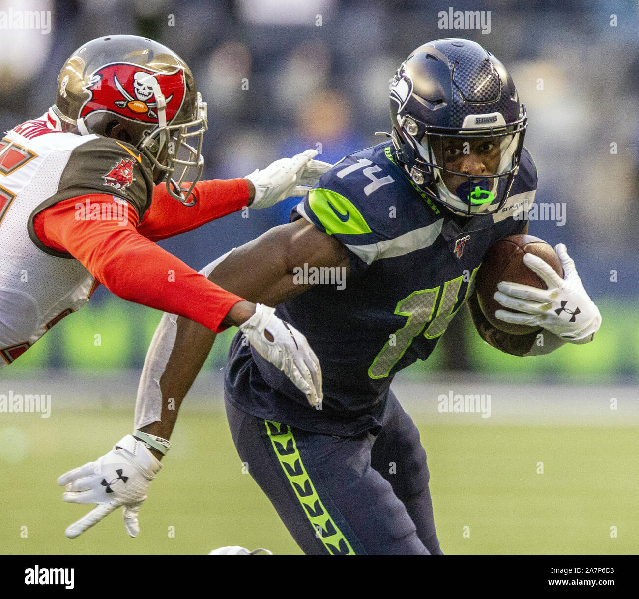 Seattle, United States. 03rd Nov, 2019. Seattle Seahawks wide receiver D.K. Metcalf (14) runs for a 14-yard gain against Tampa Bay Buccaneers defensive back Jamel Dean (35) during the fourth quarter at CenturyLink Field on Sunday, November 3, 2019 in Seattle, Washington. The Seahawks beat the Buccaneers 40-34 in overtime. Jim Bryant Photo/UPI Credit: UPI/Alamy Live News Stock Photo