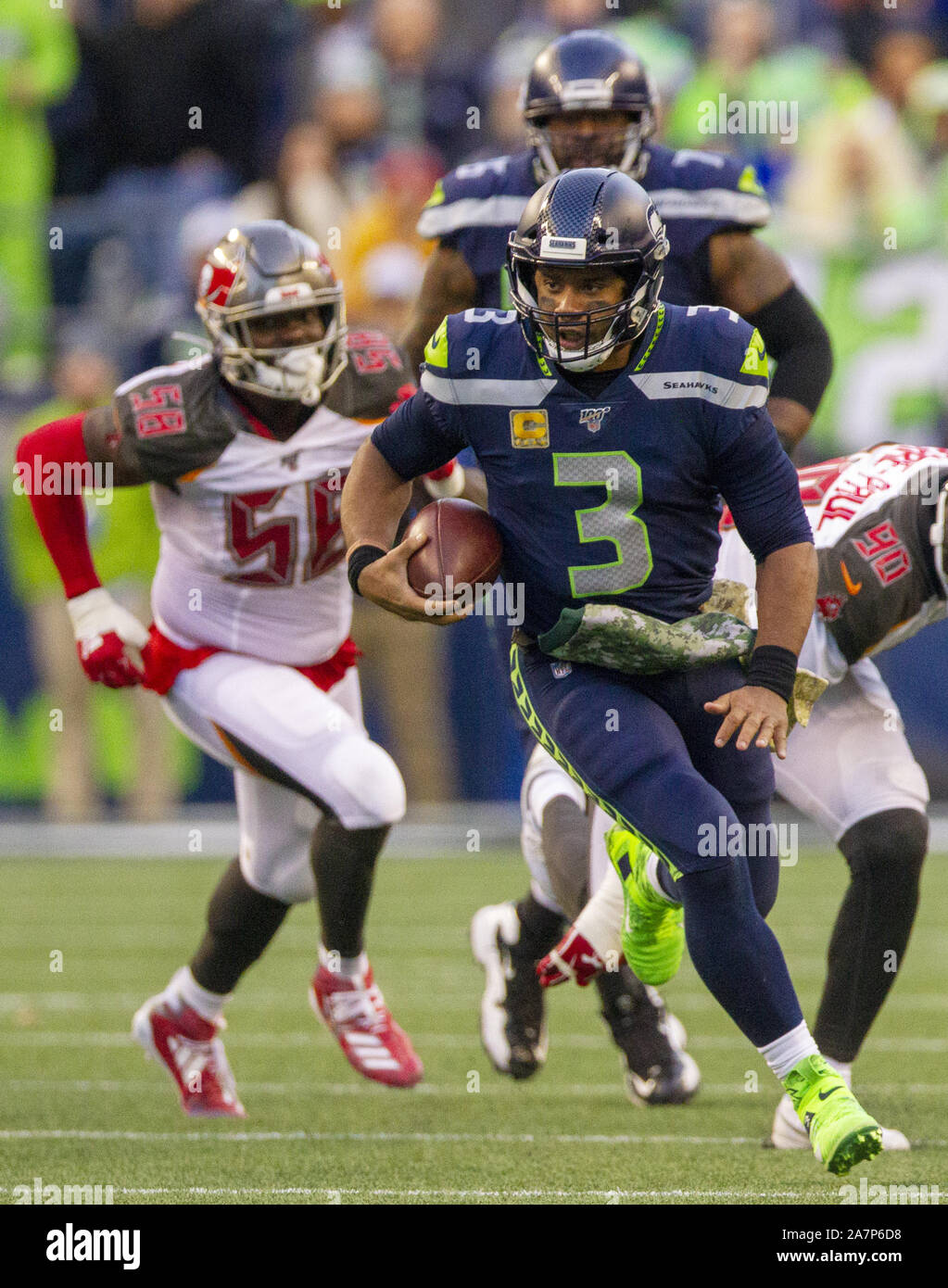 Seattle, United States. 03rd Nov, 2019. Seattle Seahawks quarterback Russell Wilson (3) scrambles against the Tampa Bay Buccaneers for a 21-yard gain during the fourth quarter at CenturyLink Field on Sunday, November 3, 2019 in Seattle, Washington. The Seahawks beat the Buccaneers 40-34 in overtime. Jim Bryant Photo/UPI Credit: UPI/Alamy Live News Stock Photo