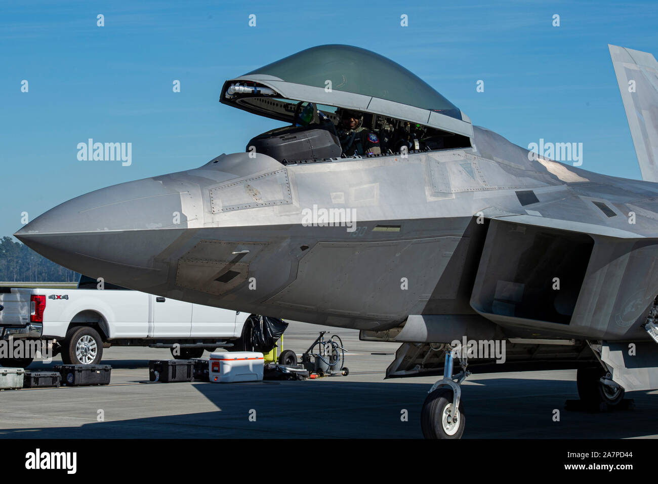 "Lt. Col. Paul ""Loco"" Lopez, F-22 Raptor Demonstration Team commander and pilot, sits in the cockpit of an F-22 during the 2019 Thunder Over South Georgia (TOSGA) Open House Nov. 3, 2019, at Moody Air Force Base, Ga. The F-22 Demonstration Team performs precision aerial maneuvers to demonstrate the unique capabilities of the fifth-generation fighter aircraft. The 2019 TOSGA Open House was headlined by the world-famous U.S. Navy Blue Angels and featured multiple demonstrations including the Smoke N Thunder jet truck and Wings of Blue Parachute Team. (U.S. Air Force photo by Airman Azaria E. Fost Stock Photo"