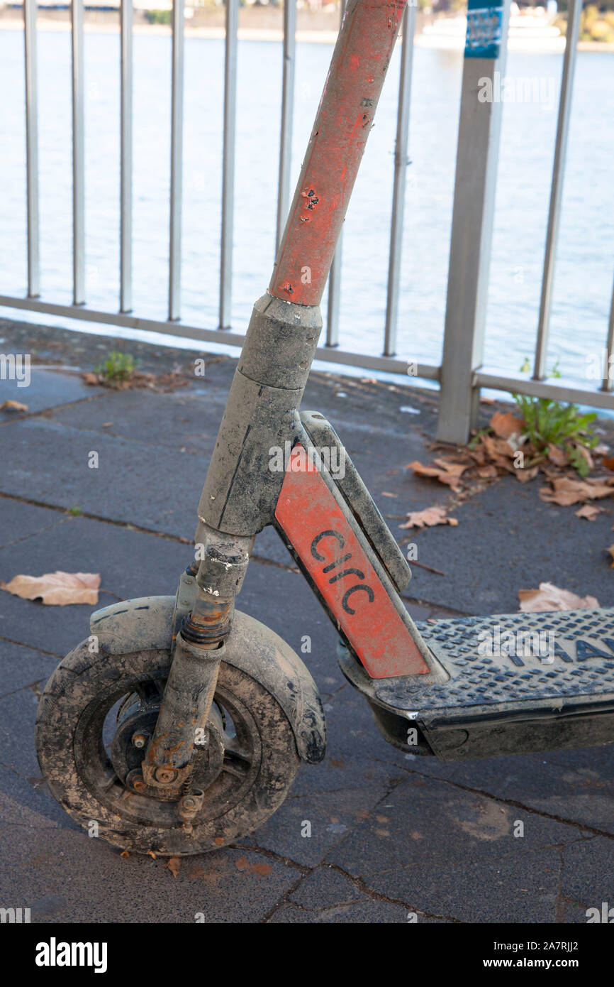 a dirty Circ electric scooter recovered from the Rhine stands on the banks of the Rhine, Cologne, Germany.  aus dem Rhein geborgener Circ Elektroscoot Stock Photo