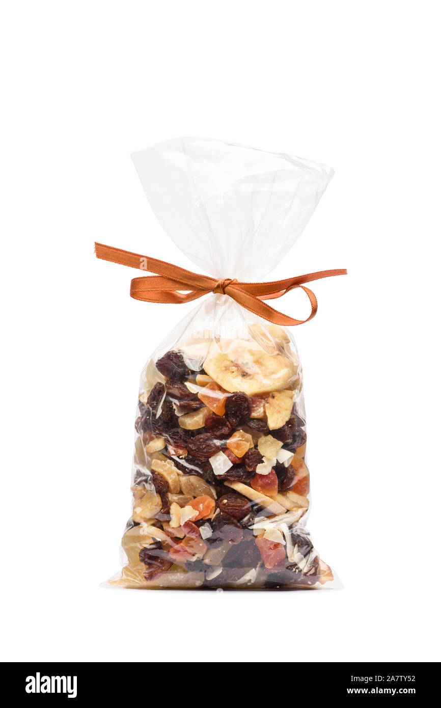 Dried fruits in transparent plastic bag on white background Stock Photo