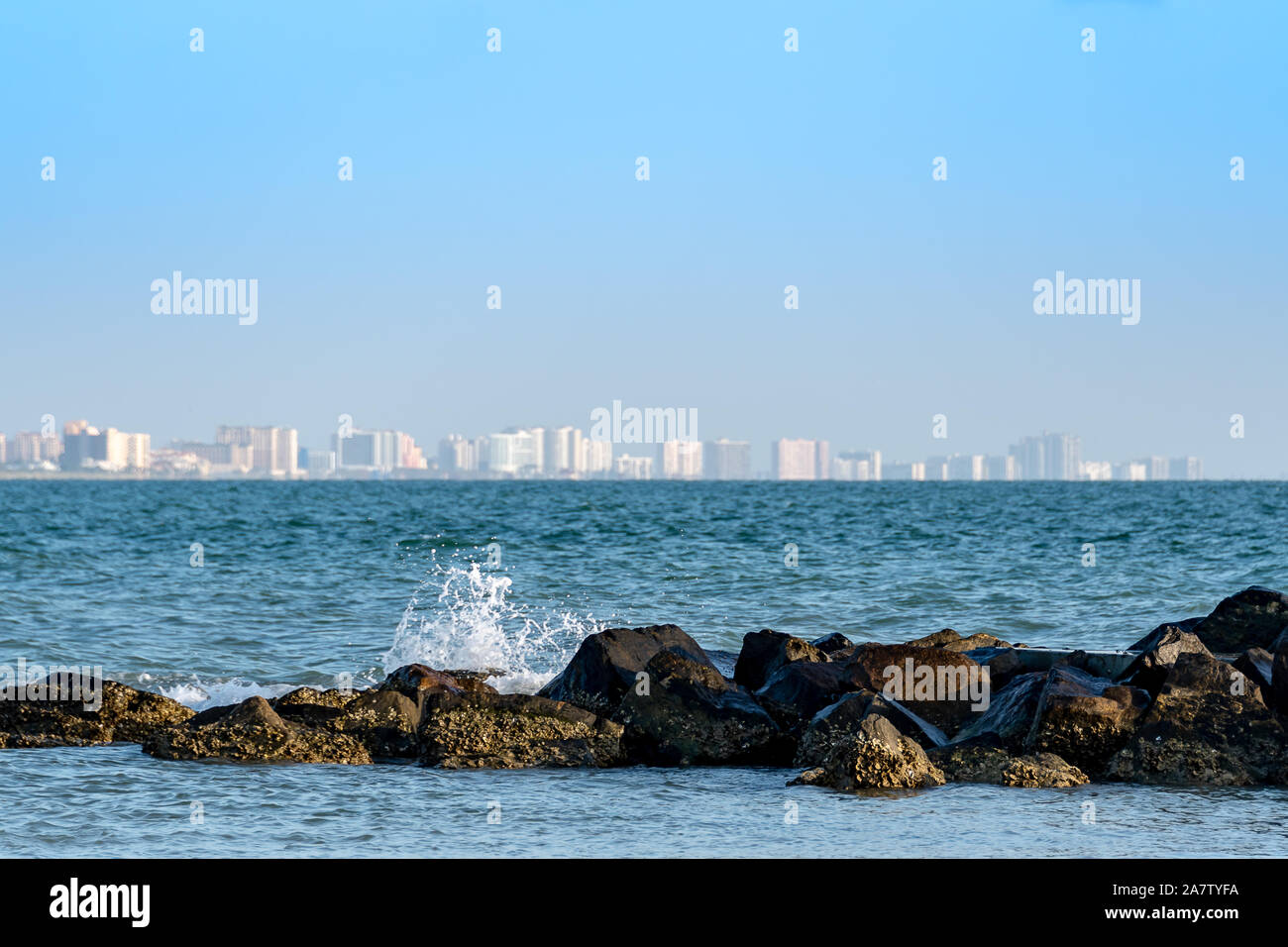 View of Clearwater, Florida with the waves crashing on the jetty Stock Photo