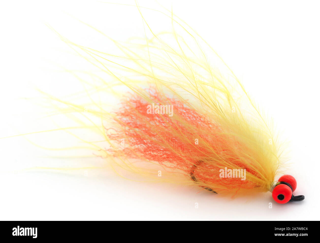 Fishing fly with hook over white background Stock Photo