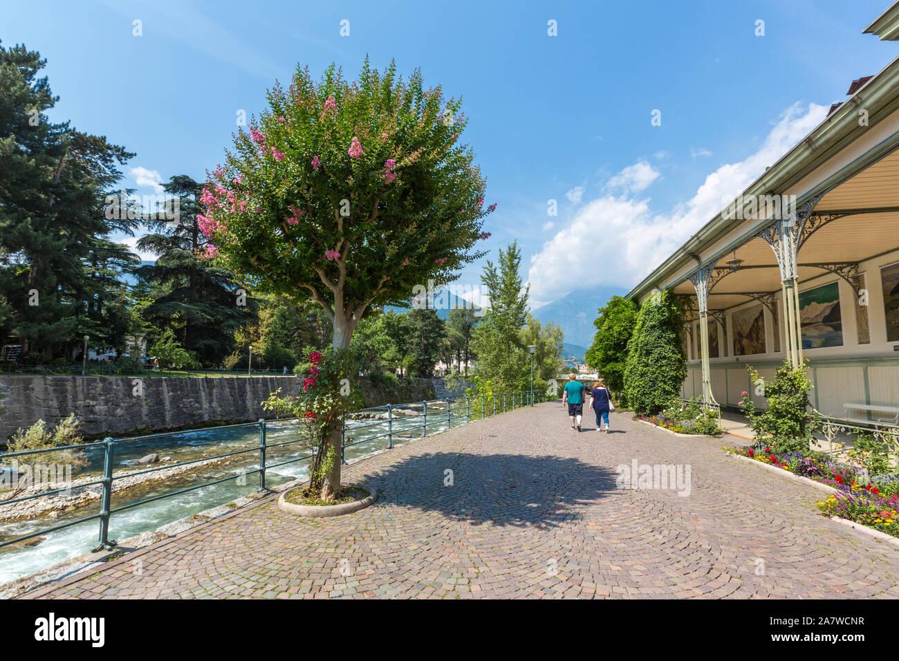 MERANO, ITALY - JULY 20, 2019 - Merano Winterpromenade along the torrente Passirio. Its most distinctive landmark is the Wandelhalle covered passagewa Stock Photo