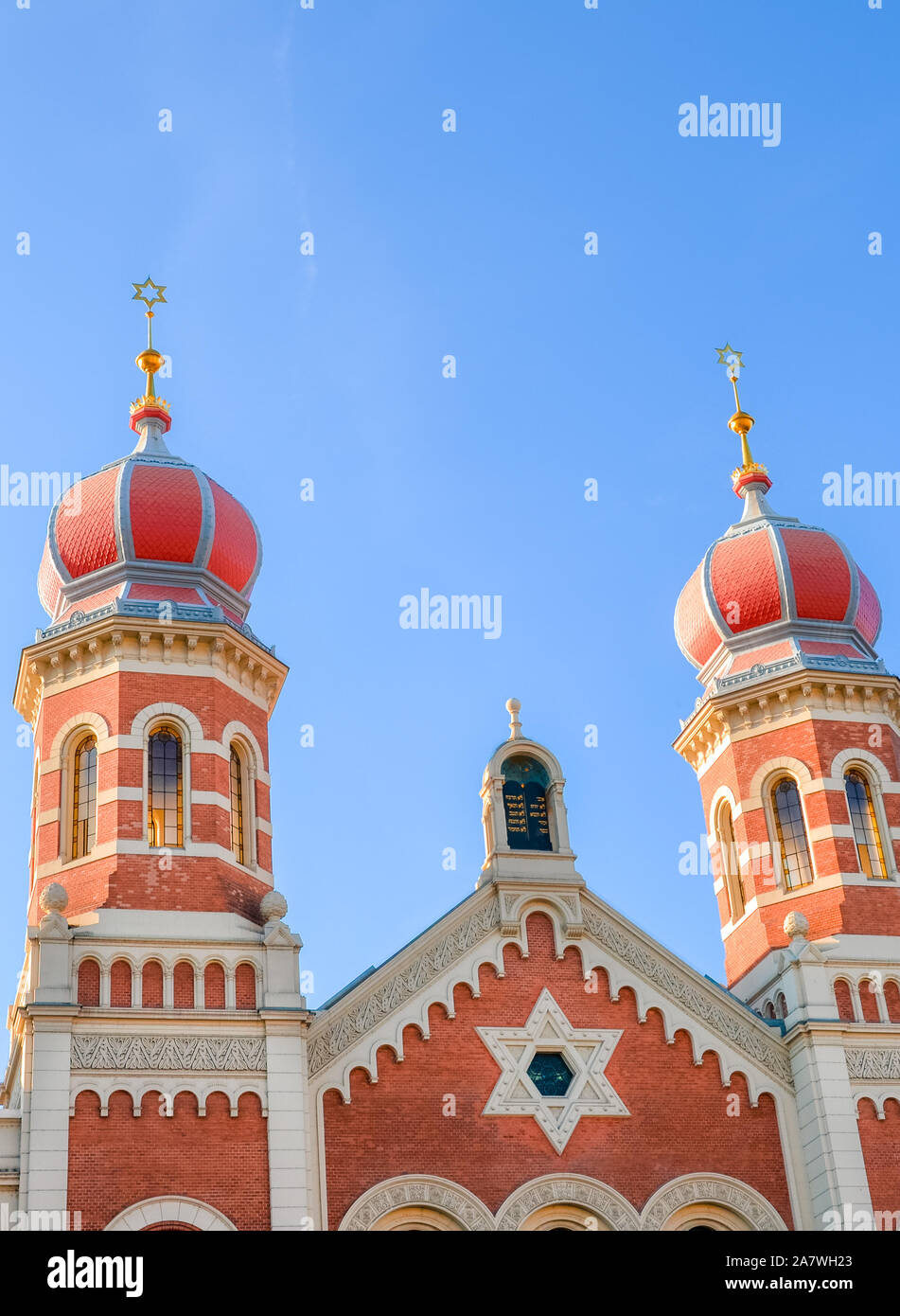 Vertical photo of the Great Synagogue in Plzen, Czech Republic. The second-largest synagogue in Europe. Detail of facade of the Jewish religious building with two onion domes. Tourist landmarks. Stock Photo