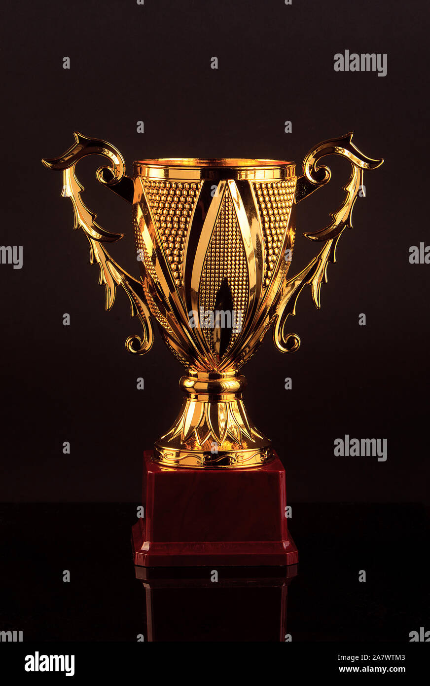 Trophy cup on black background Stock Photo