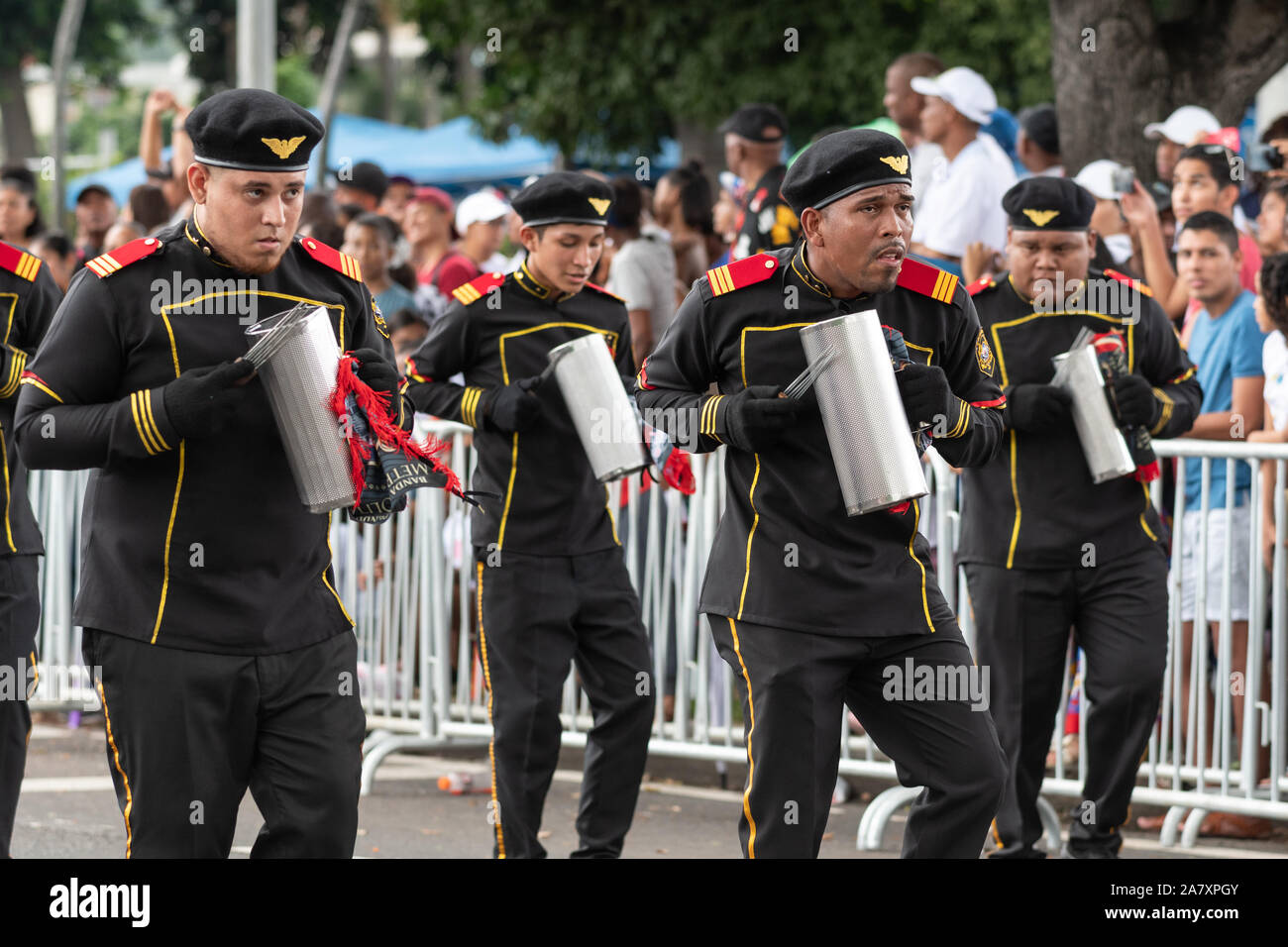 Young men in uniform playing instruments during parade at Flag Day, a national public holiday in Panama. Stock Photo
