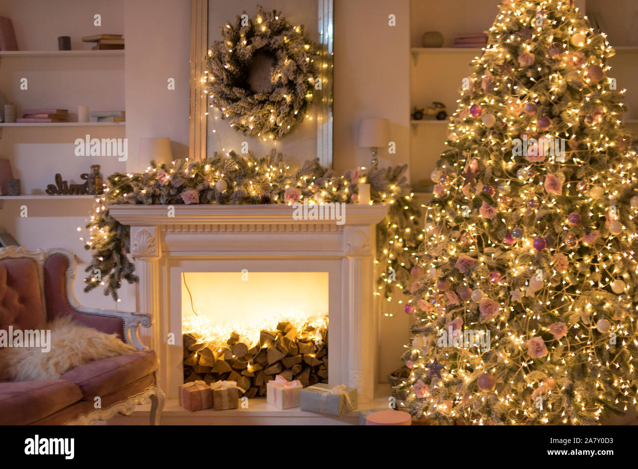 Warm Cozy Evening Christmas Eve Christmas Room With Fireplace Interior Design Xmas Tree Decorated By Lights Gifts Toys Garland Lighting Fireplace Stock Photo Alamy