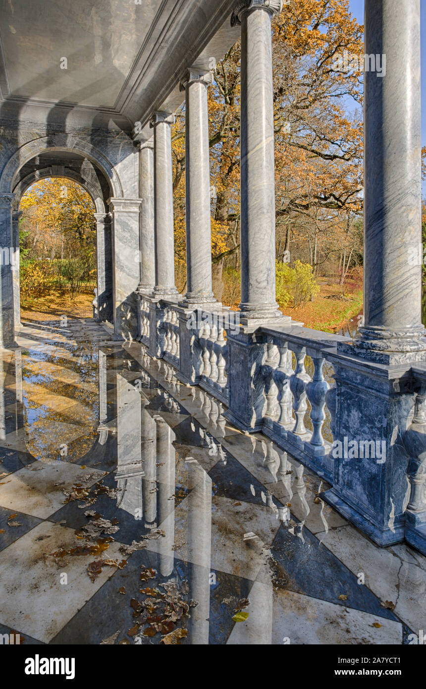 Columns of the Siberian Marble bridge inside with reflections during the Indian summer (Tsarskoye Selo, Saint Petersburg, Russia) vertical orientation Stock Photo
