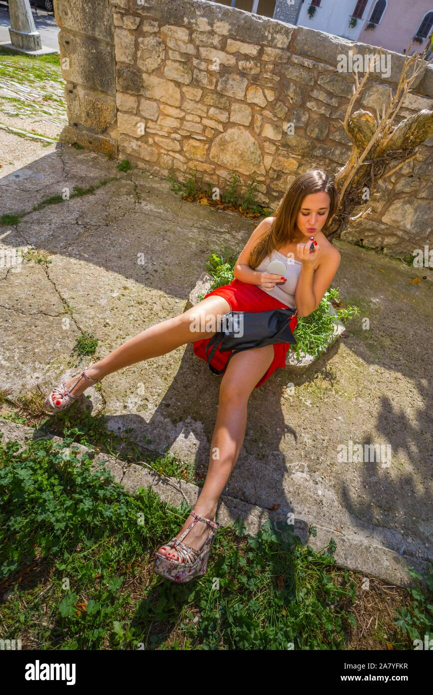 Teen teenage teenager female 18-20 yo years adolescent pretty beautiful attractive one single solo human being person spread legs sitting on ground Stock Photo