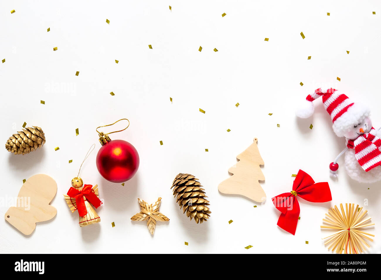 Christmas Decorations In Gold And Red On A White Background