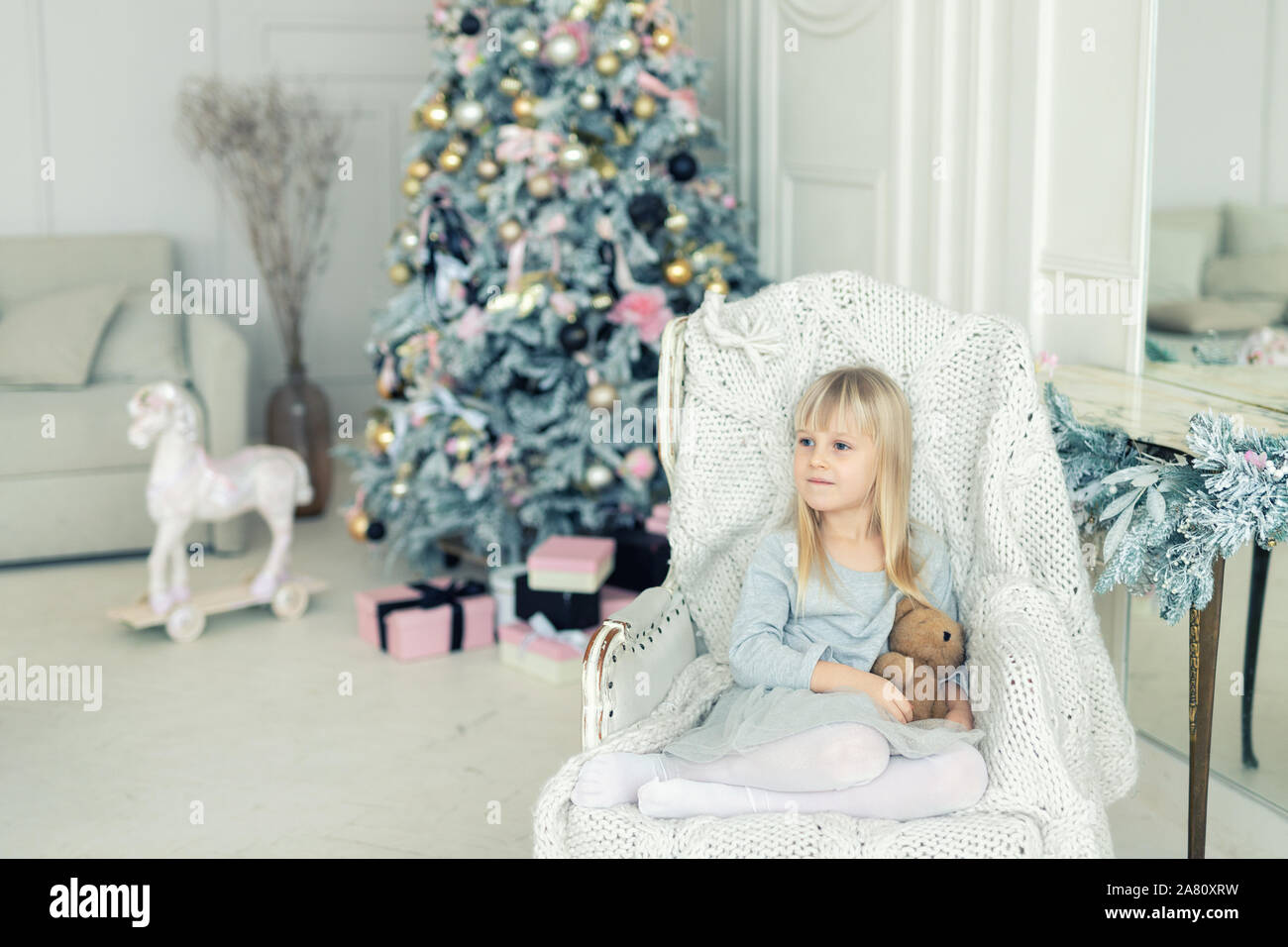 Cute Adorable Little Girlsitting In Chair Near Christmas