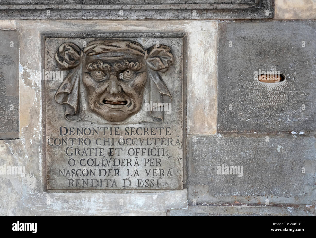 The Mouth of Secret Accusations in the Doge's Palace Venice Italy inviting citizens to grass on enemies of the state by letter Stock Photo