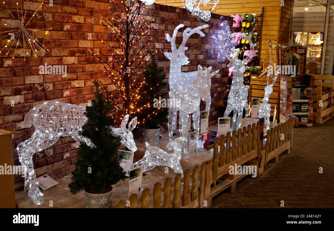 Christmas  Outdoor  Large  and Small  LED White Mesh Reindeer Decorations in a Garden Centre in Surrey UK. Stock Photo