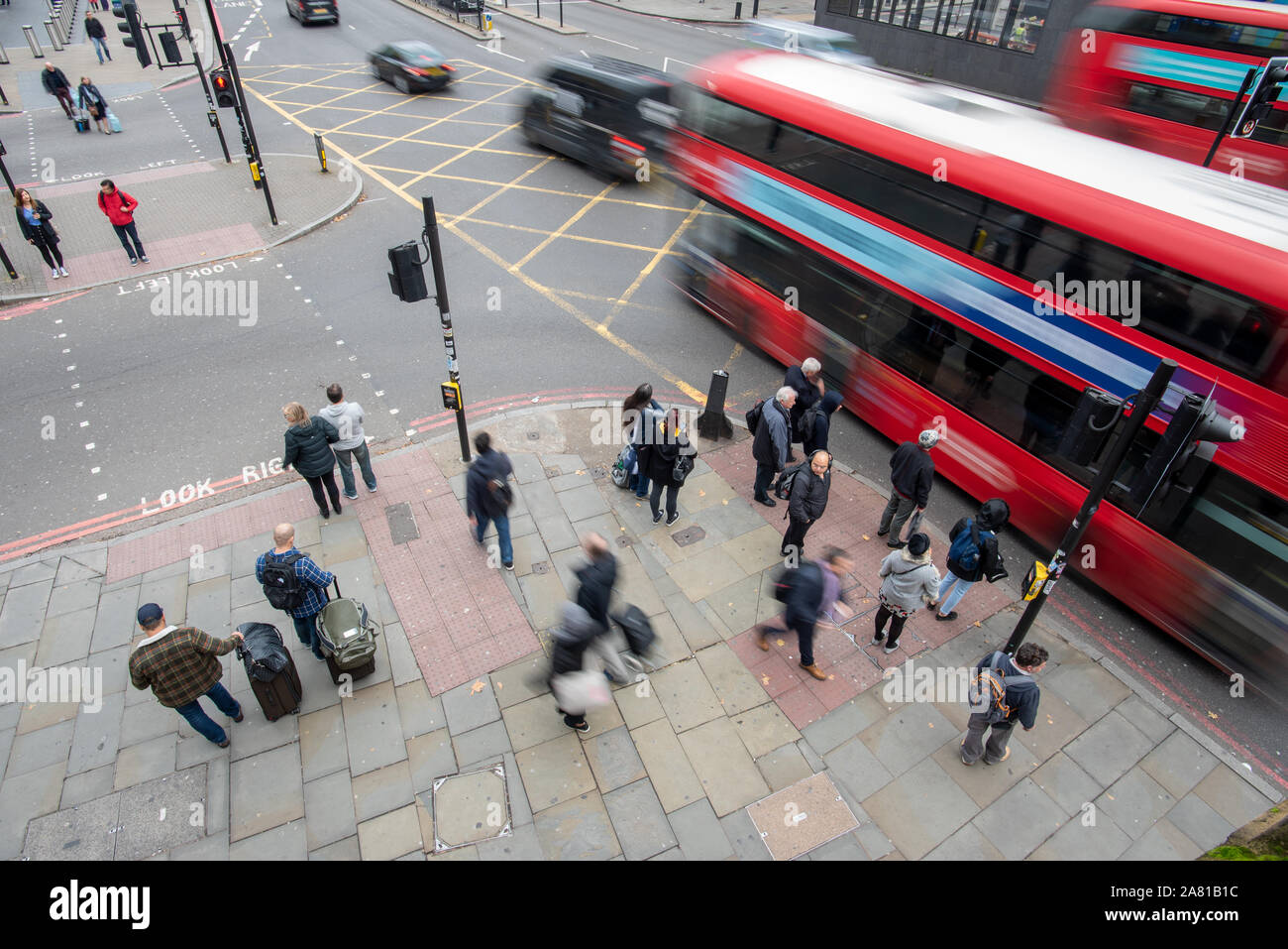 London, United Kingdom - November 5, 2019: People moving in all directions outside St. Pancras Station on a cloudy day. Stock Photo