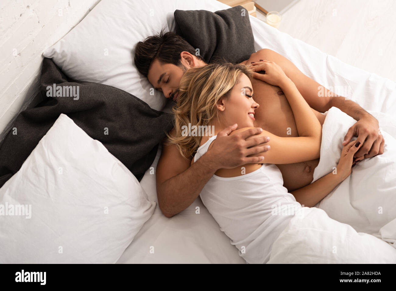 Happy Smiling Couple Hugging In Bed In The Morning Stock Photo Alamy