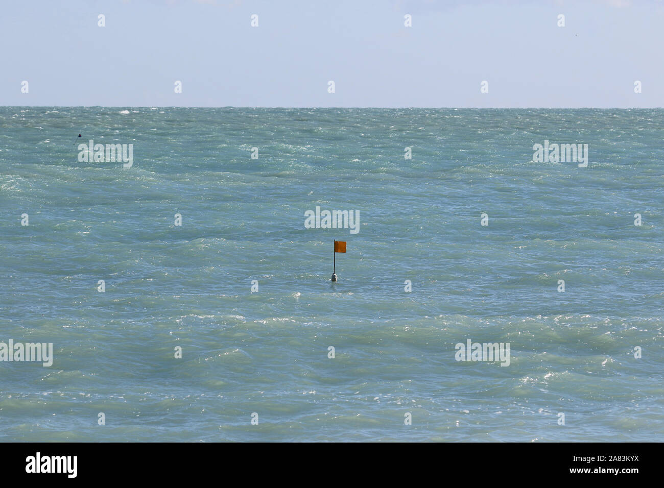 marker flag for a clam or mussel fishing pot in the Adriatic sea near Ancona in Italy in early spring Stock Photo