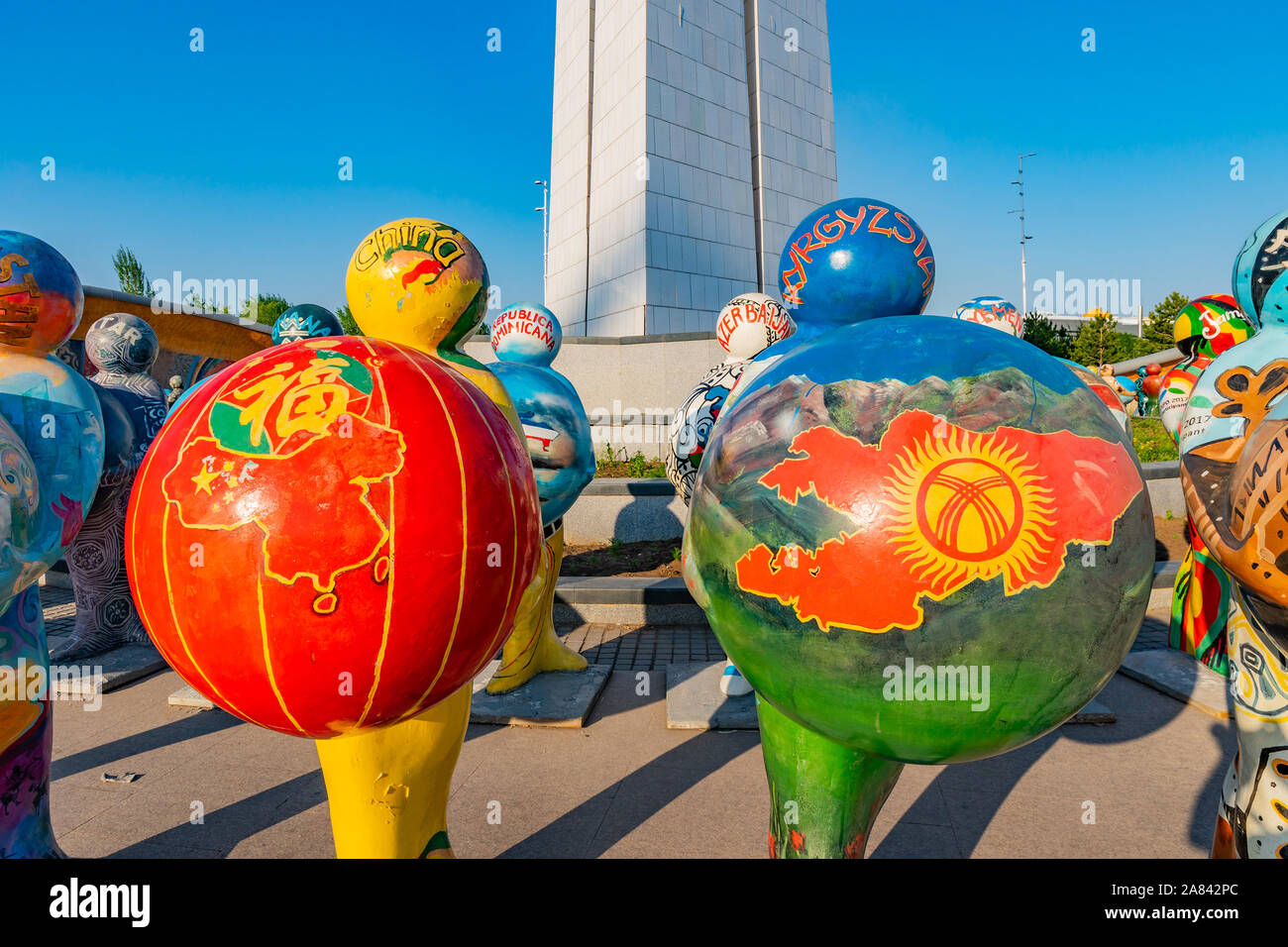 Nur-Sultan Astana Central City Tsentralnyy Gorodskoy Park View of Sculpture Holding China and Kyrgyzstan Balls on a Sunny Blue Sky Day Stock Photo