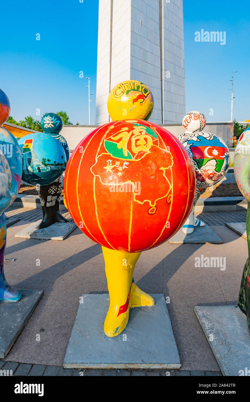 Nur-Sultan Astana Central City Tsentralnyy Gorodskoy Park View of Sculpture Holding China Ball on a Sunny Blue Sky Day Stock Photo