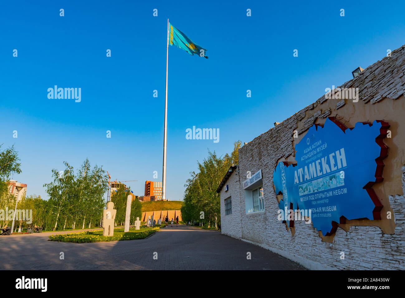 Nur-Sultan Astana Central City Tsentralnyy Gorodskoy Park View of Atameken Museum and Waving Kazakhstan Flag on a Sunny Blue Sky Day Stock Photo