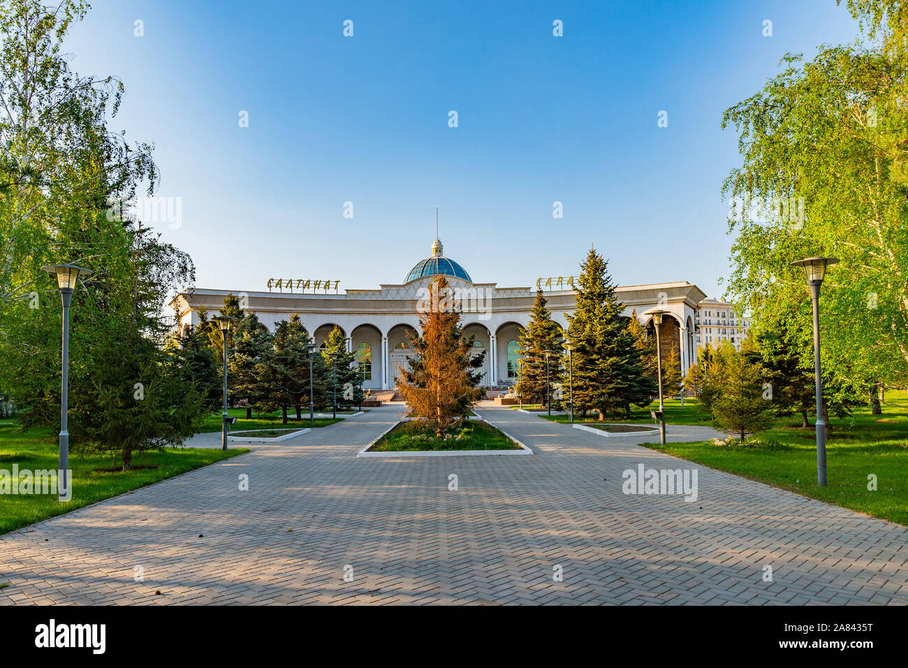Nur-Sultan Astana Central City Tsentralnyy Gorodskoy Park View of Saltanat Sarayy Building on a Sunny Blue Sky Day Stock Photo