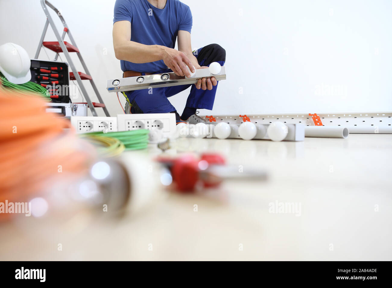 Electrician At Work With Tools Puts The Bulbs On A Lamp At Home Electric Circuits Electrical Wiring Stock Photo Alamy