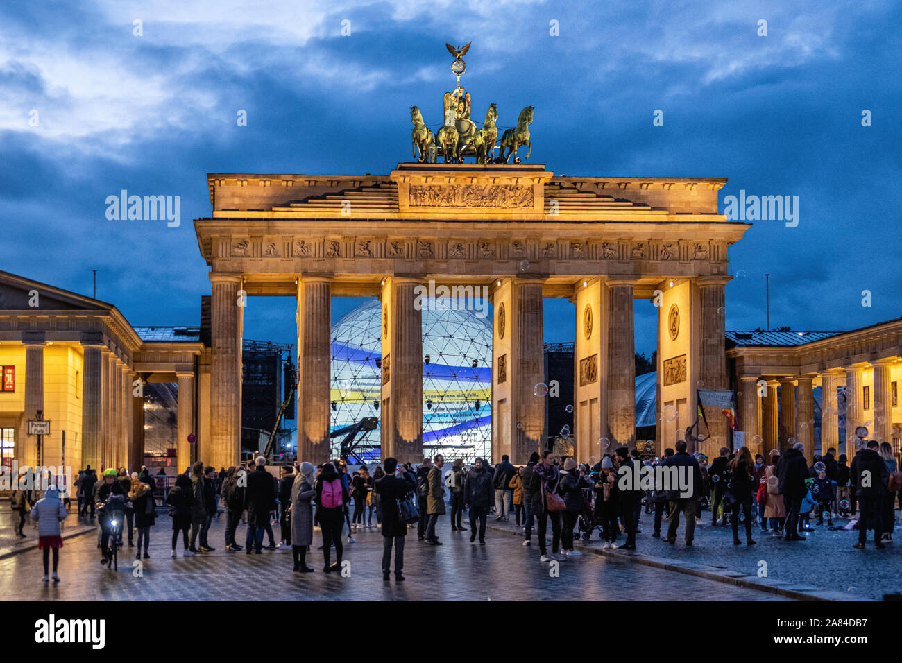 People collect at Brandenburger Tor to celebrate 30th Anniversary of the fall of the Berlin Wall, Pariser Platz, Mitte, Berlin, Germany Stock Photo
