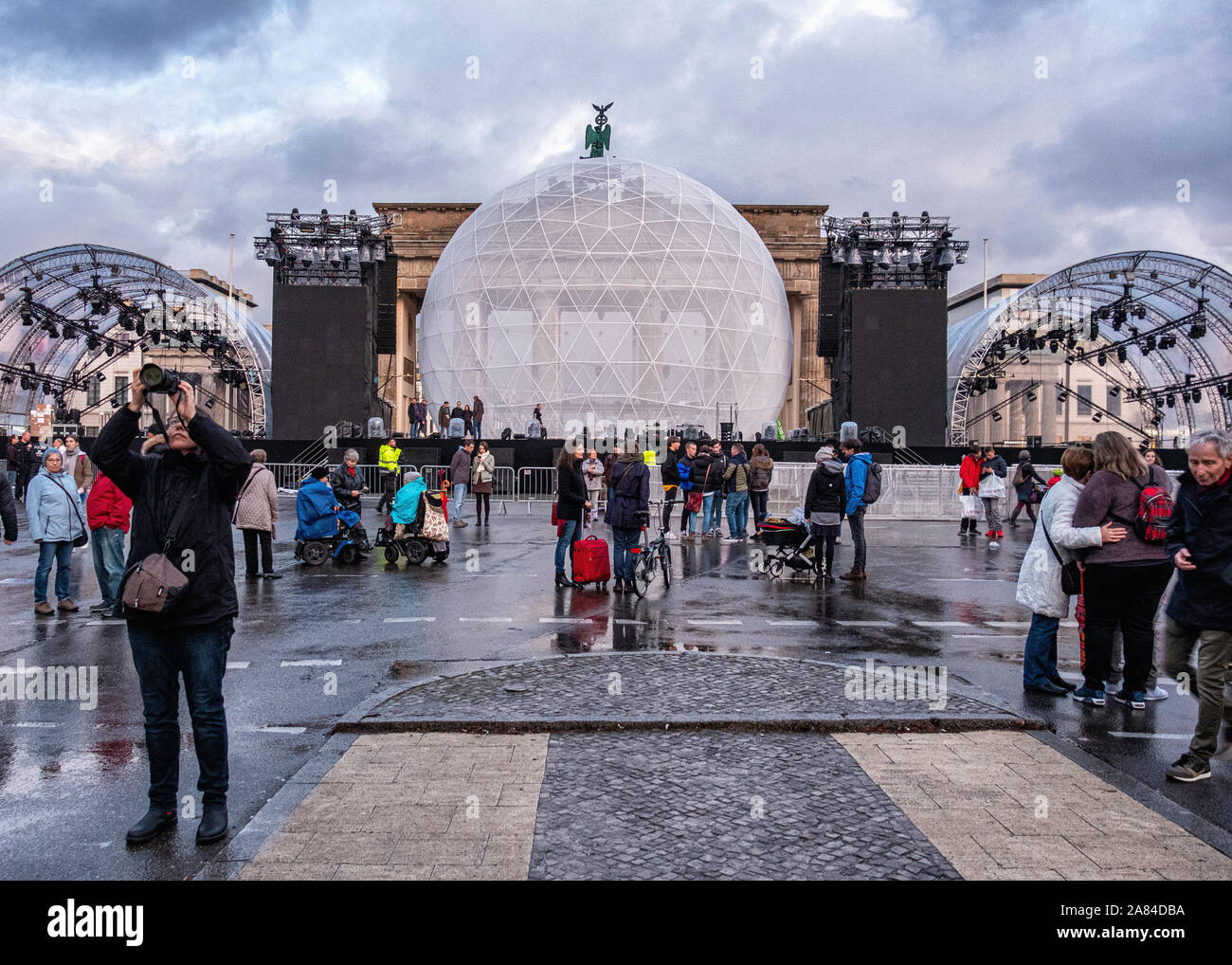 Celebrating 30th Anniversary of the Fall of the Berlin Wall. Concert stage and Huge white globe that is illuminated with messages of peace after dark at the Brandenburg gate, Straße des 17. Juni, Berlin Stock Photo