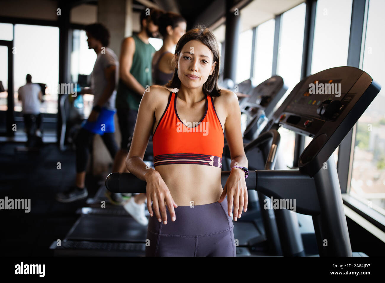 Disappointed tired woman trying to reach fitness goals by endurance and stamina training Stock Photo