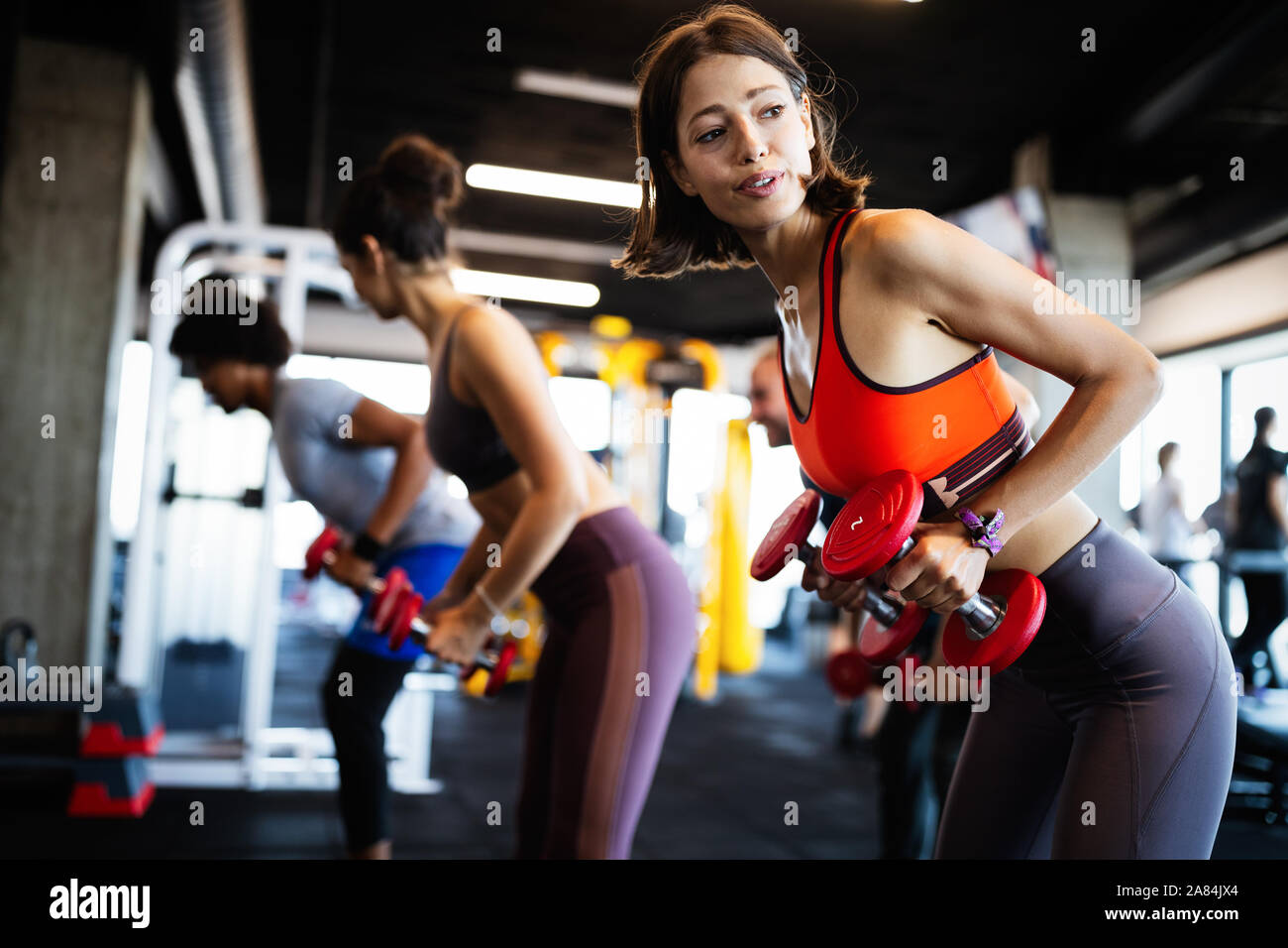 Beautiful Fit Women Working Out In Gym Stock Photo Alamy Find the confidence to give your training everything, in the greatest of women's workout wardrobes. alamy