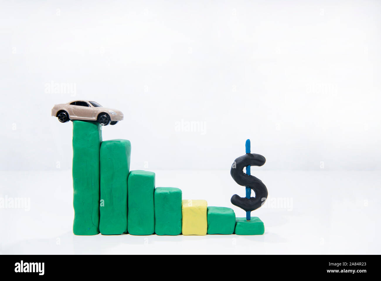 Abstract composition of car prices in auto-market. Isolated on white background. Stock Photo