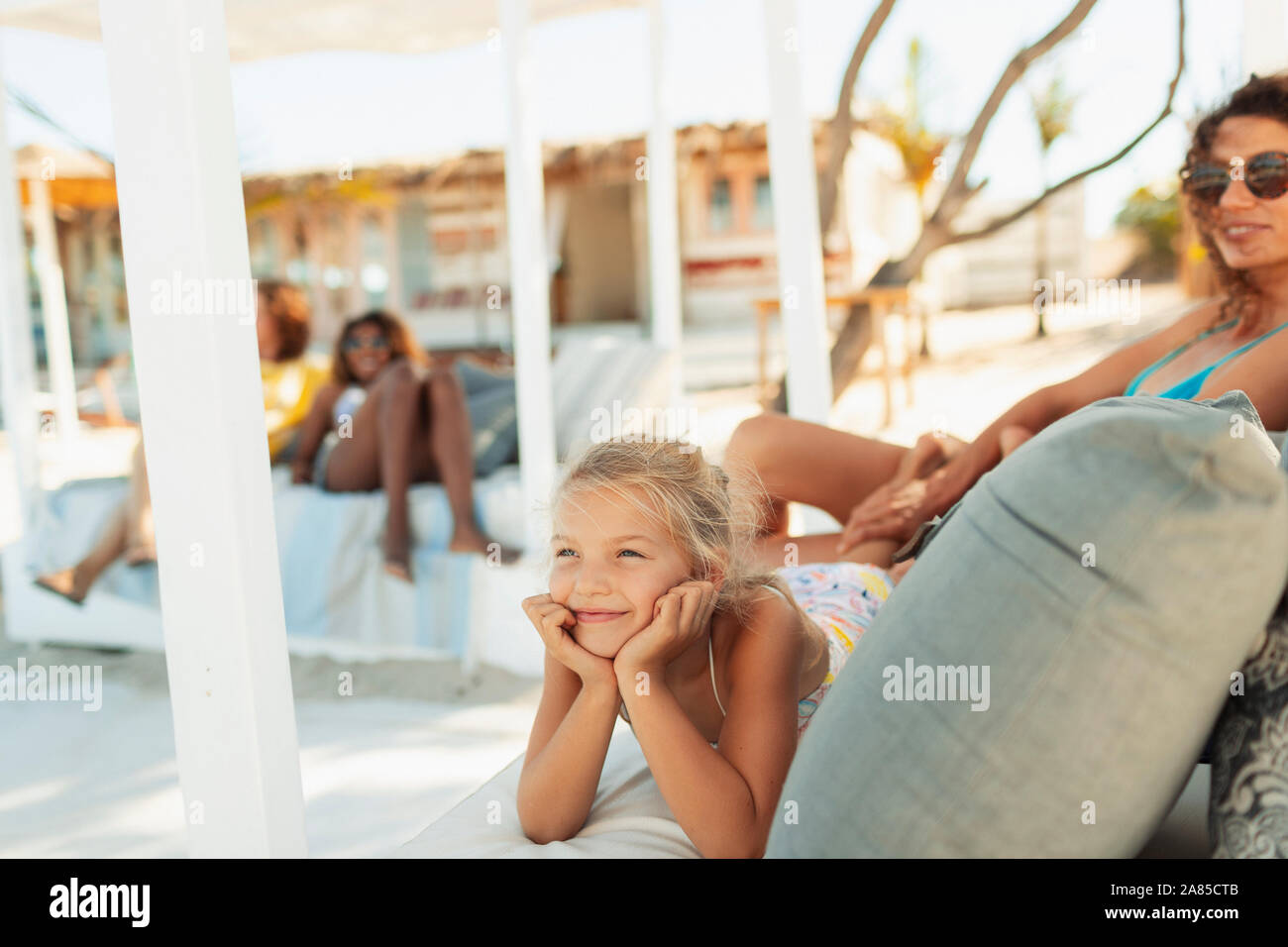 Carefree girl relaxing on beach patio Stock Photo