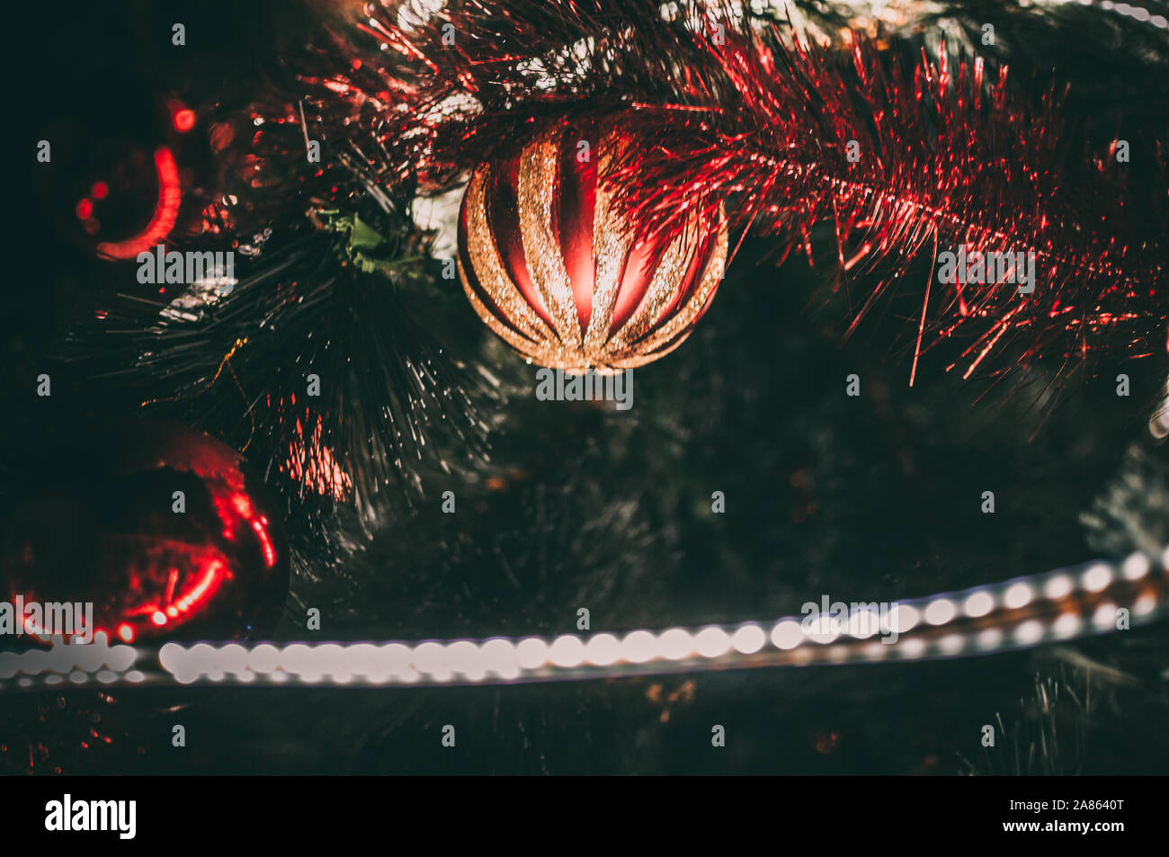 Decorated Christmas Tree Close Up Red Balls And A Garland With Illumination With Lanterns New Year S Baubles Macro Photo With Bokeh Winter Holiday Stock Photo Alamy