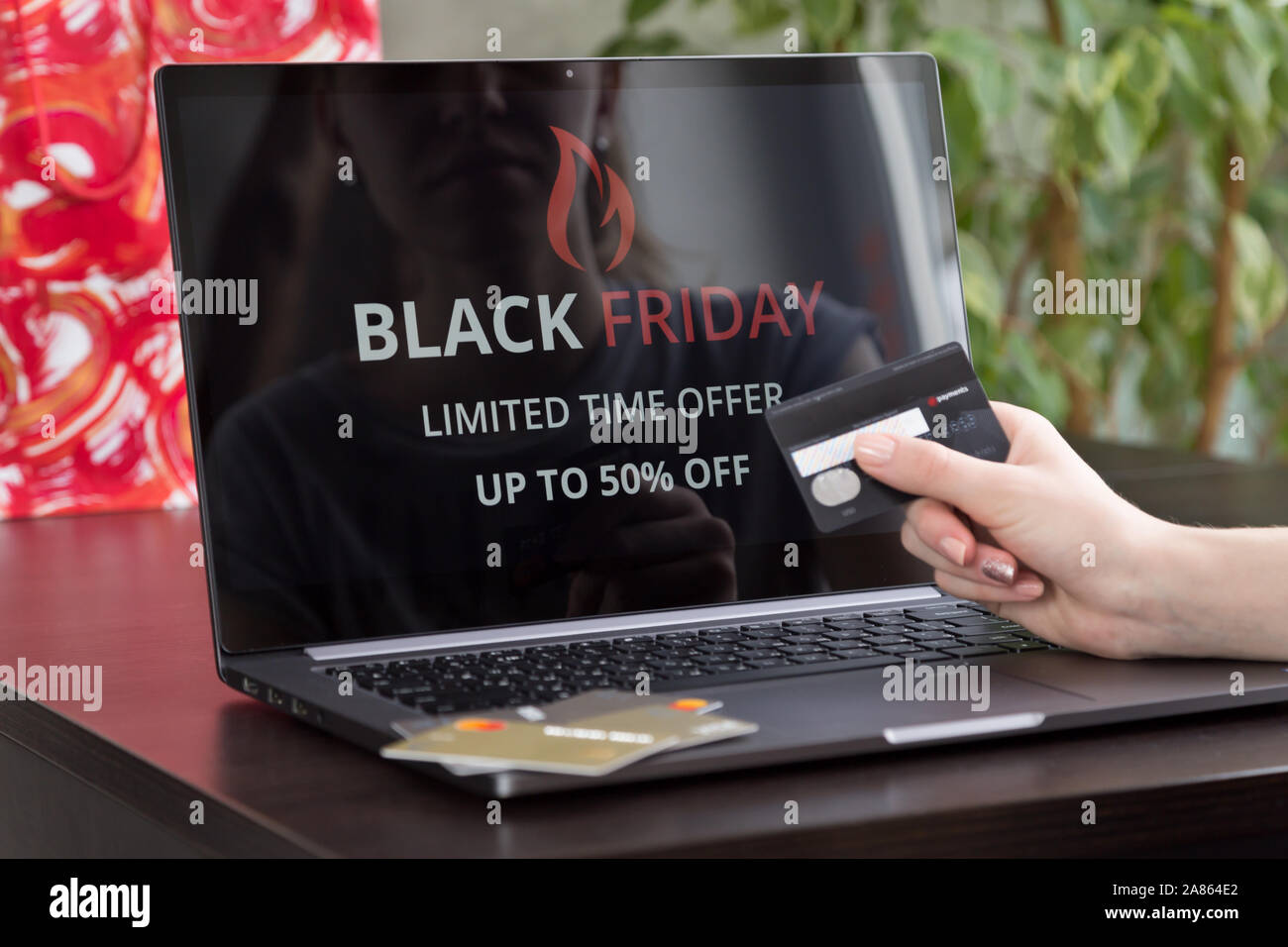Girl Sits At A Laptop And Makes Purchases Over The Internet On Black Friday Fast And Easy Trading Concept Stock Photo Alamy