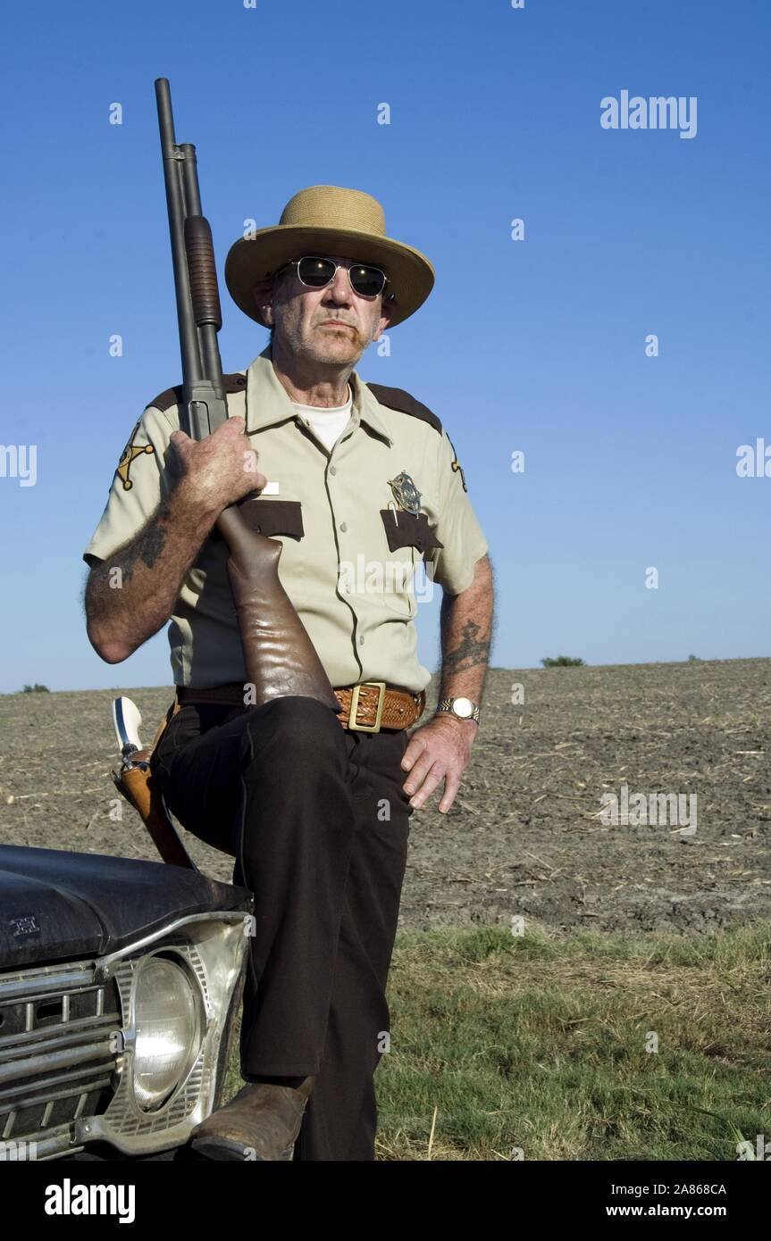 R. LEE ERMEY, THE TEXAS CHAINSAW MASSACRE: THE BEGINNING, 2006 Stock Photo