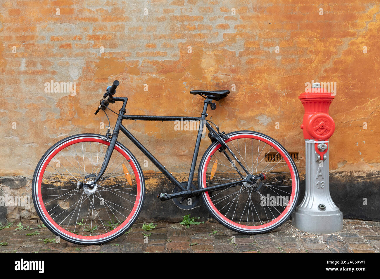 Bicycle in front of an old house in Copenhagen in the district Østervold Stock Photo