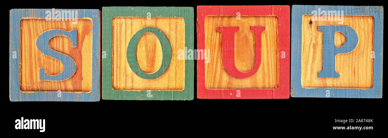 High resolution scan of old toy wooden blocks spelling out the word SOUP. This is isolated on a black background. Stock Photo