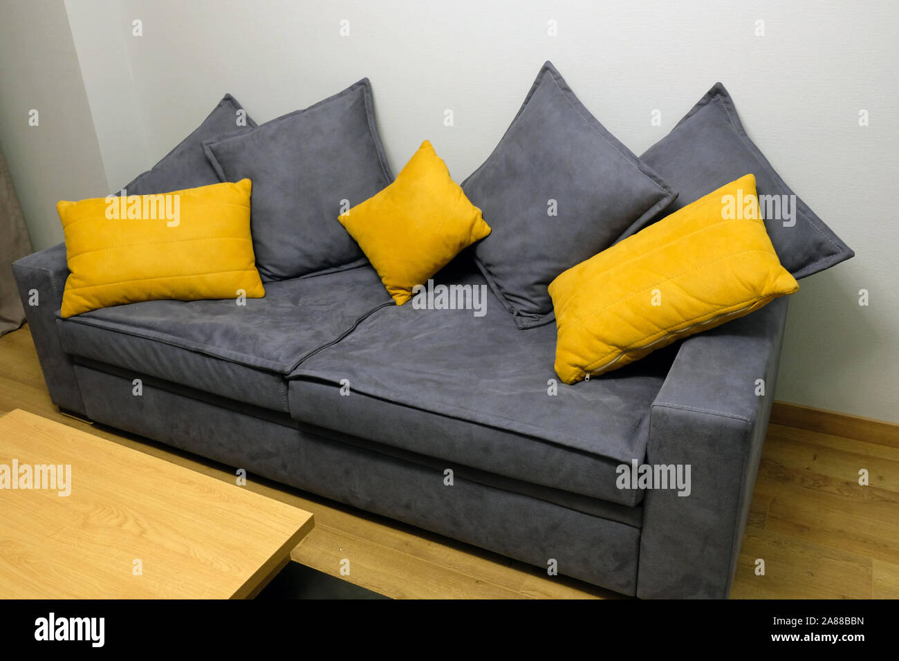 Grey Big Sofa With Yellow And Grey Pillows The Couch In The Room Is Close Up Stock Photo Alamy