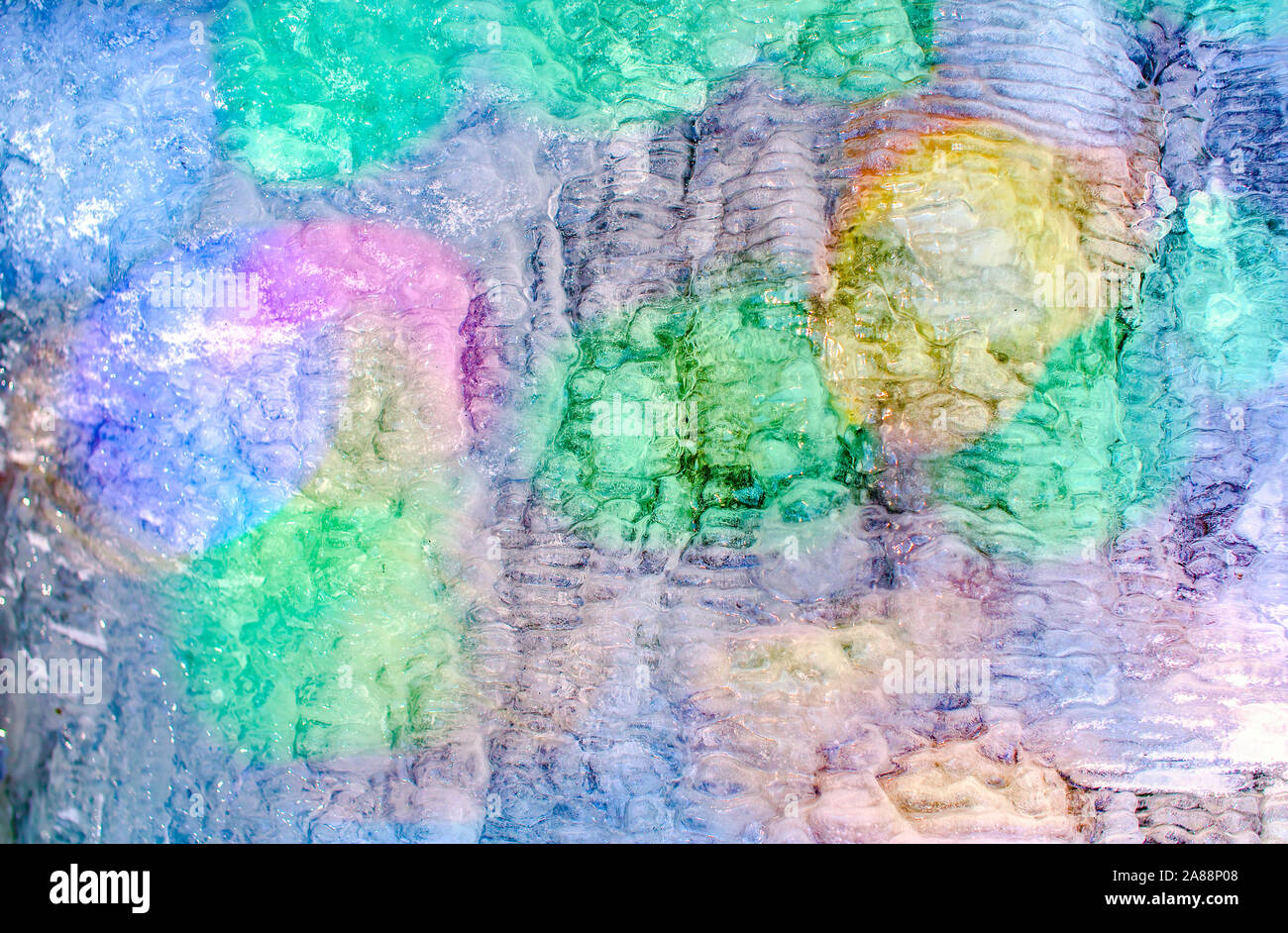 Colorful lights on phantasmagoric  shapes of ice layer Stock Photo