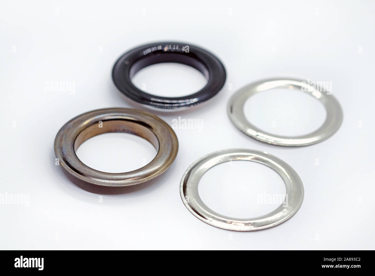 Metal Eyelets With Reverse Ring Dark Nickel And Black Lacquered Accessories For Clothes Shoes And Bags Metal Base For The Hole In Which The Cord I Stock Photo Alamy
