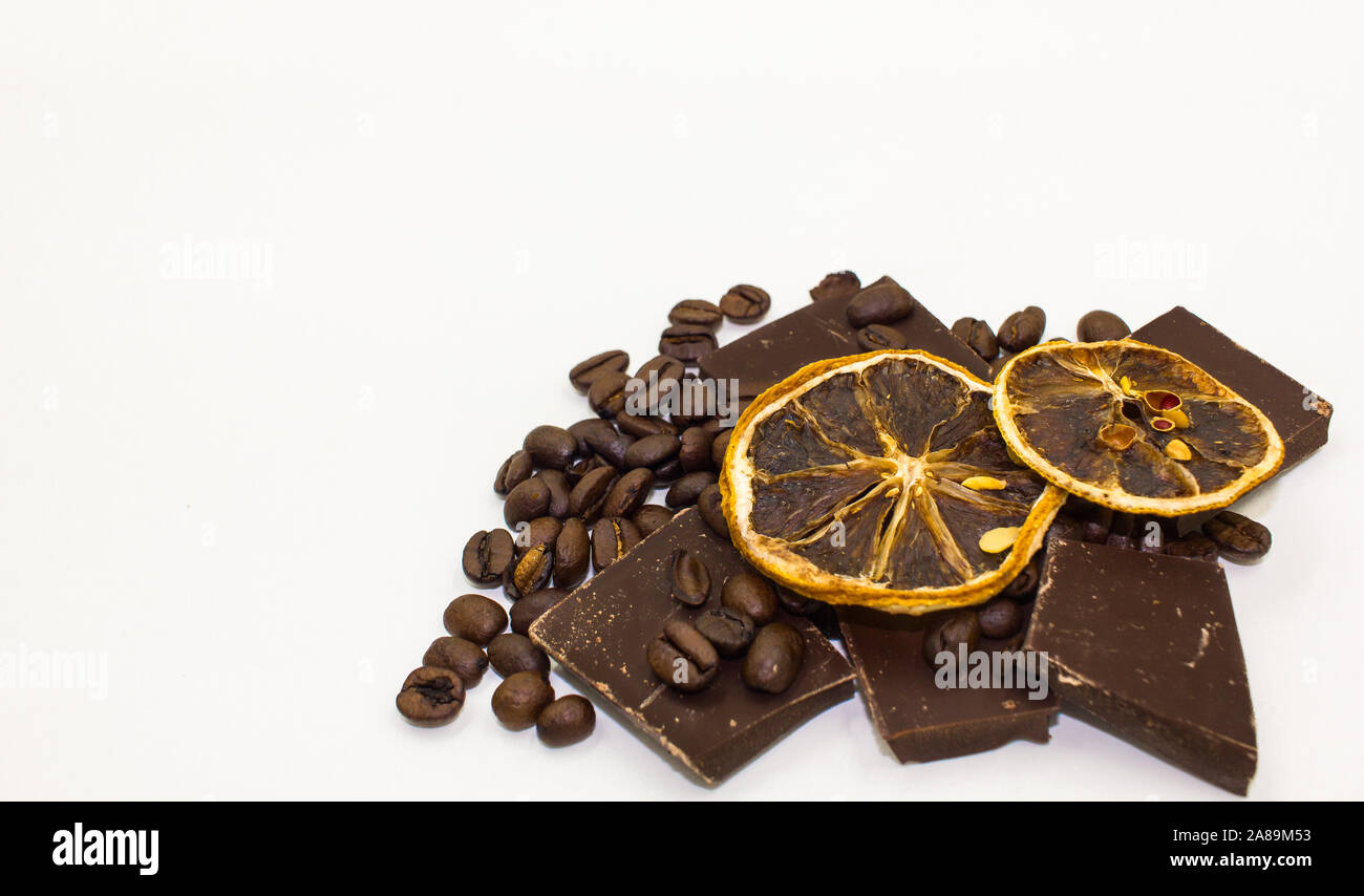 Dried Orange Slices on Dark Chocolate Pieces and Coffee Beans - White Background, Room for Text Stock Photo