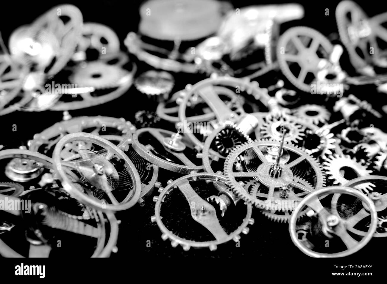 Vintage cogs gears wheels collection set on black background Stock Photo
