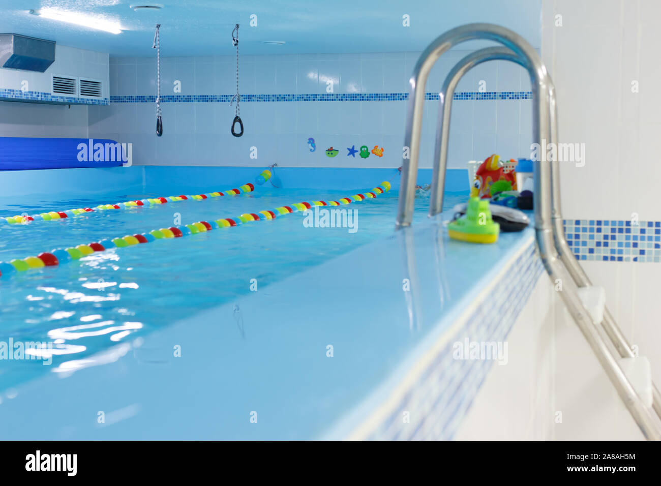 Empty indoors public swimming pool. sports rings. children center, pool Stock Photo