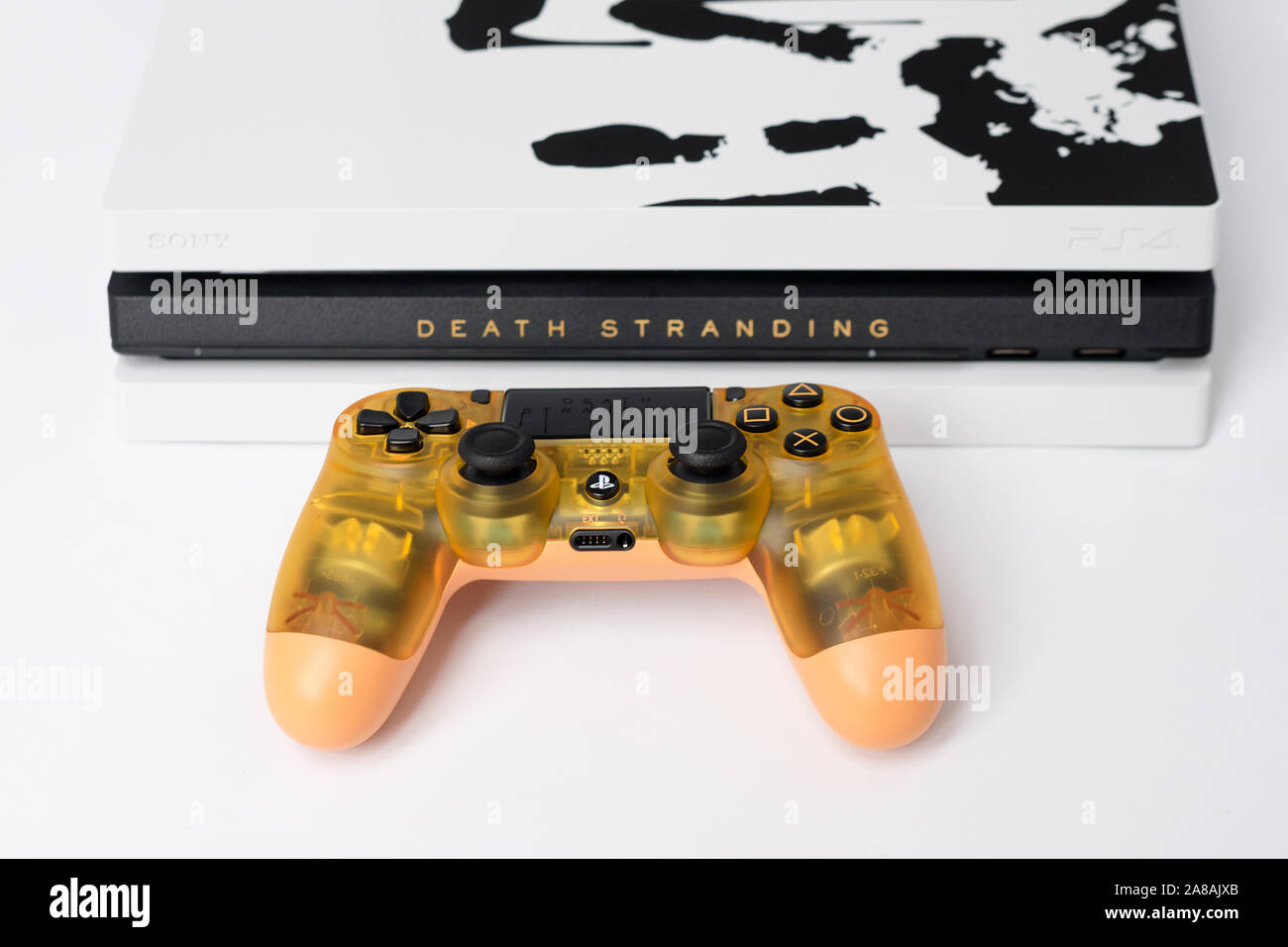 Kiev Ukraine November 07 2019 Death Stranding Limited Edition Ps4 Pro Sony Playstation 4 Game Console And Transparent Controller On White Stock Photo Alamy