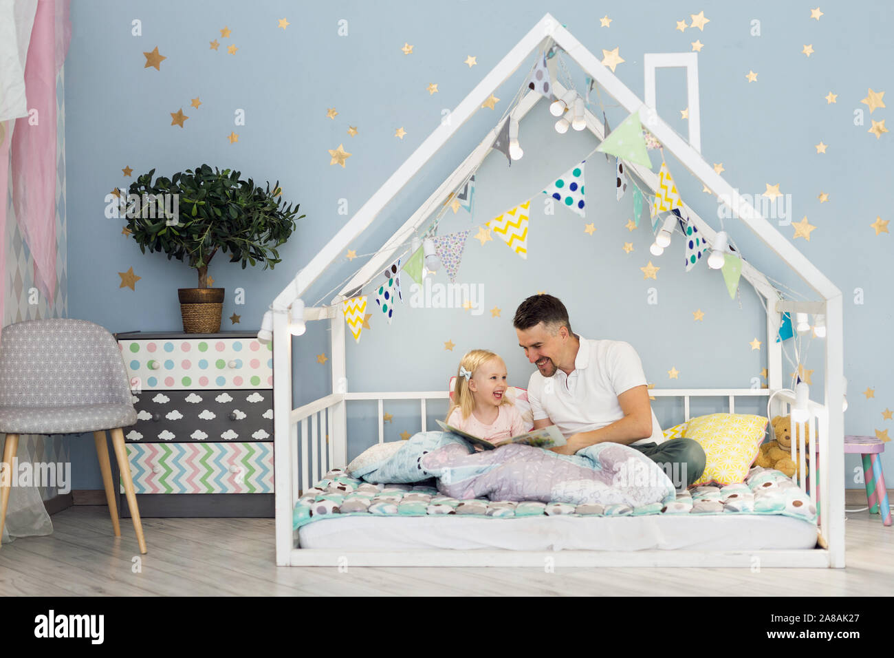Happy Father Laughing With His 3 Years Old Girl While Sitting On White House Bed In Children Bedroom Stock Photo Alamy