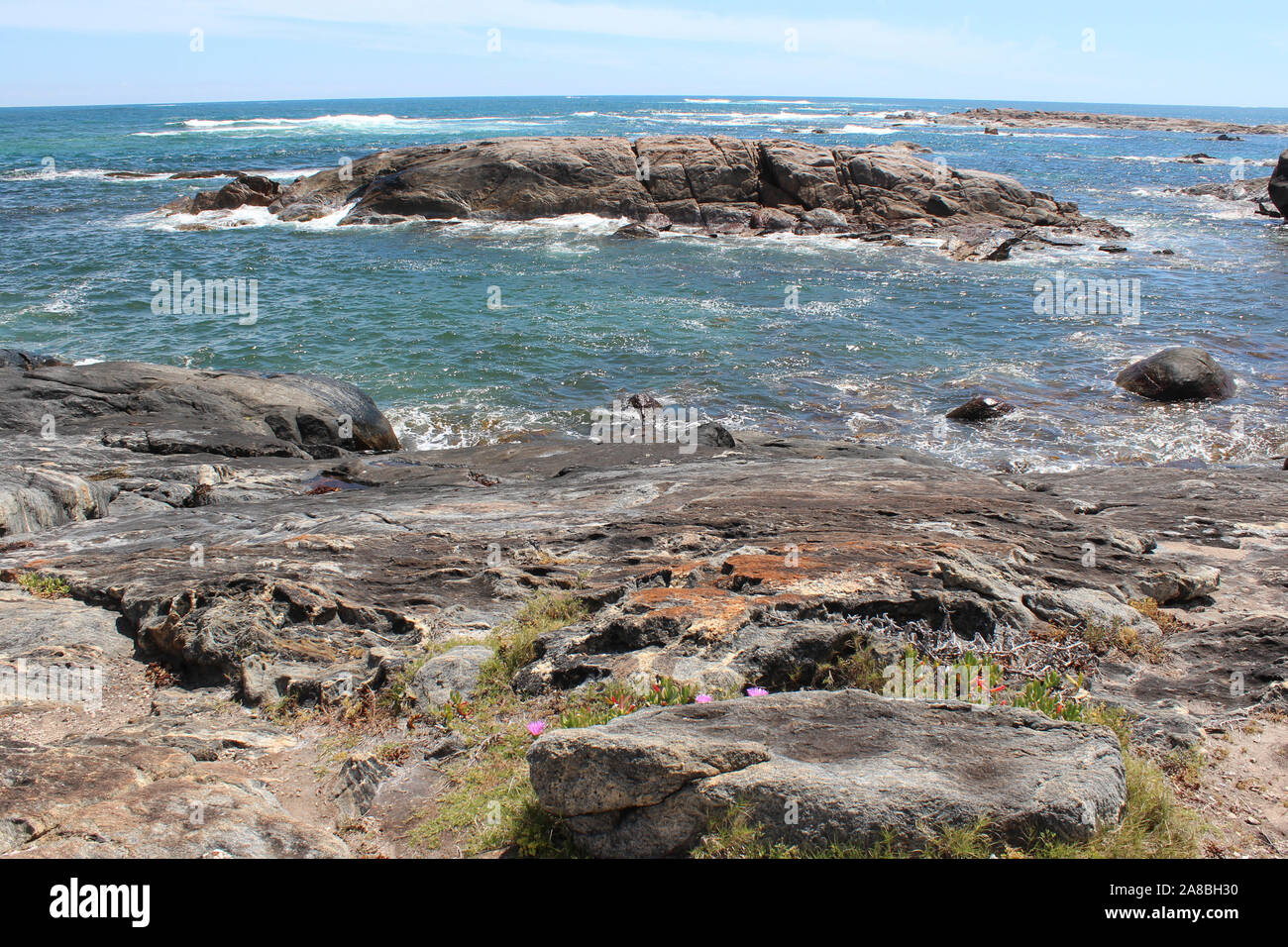 A few kilometers from Cape Leeuwin, Western Australia, where the Indian and Southern Oceans meet this scenic view is seen from the Skippy Rock lookout. Stock Photo