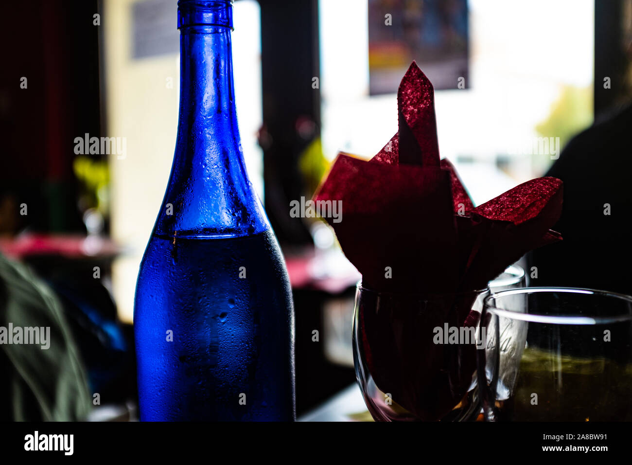 Blue Bottle Of Water On A Dark Restaurant Stock Photo Alamy