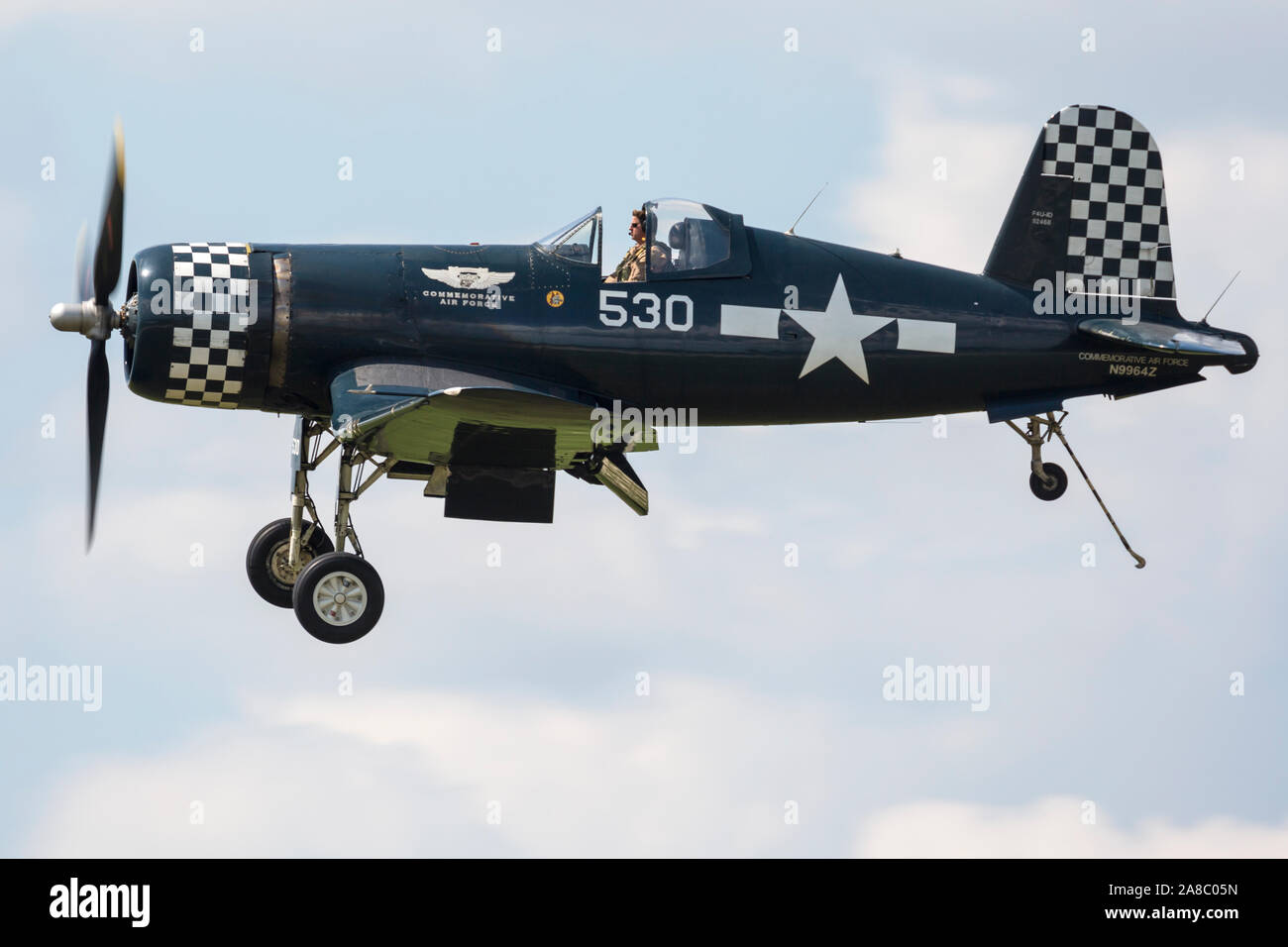 An F4U Corsair performs a flyby at the 2019 Thunder Over Michigan Airshow. Stock Photo