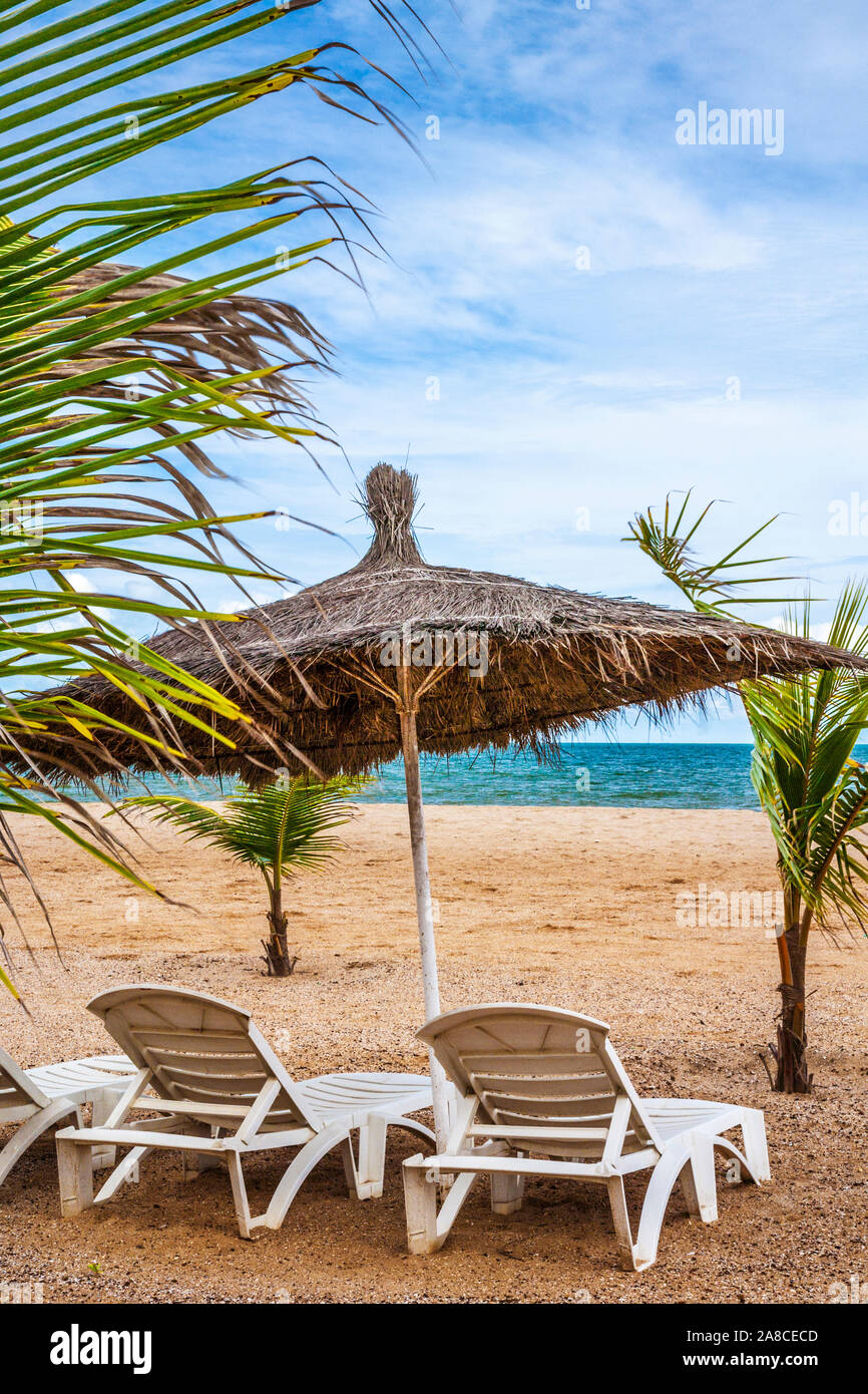 The private beach area of a luxury holiday complex in the Gambia, West Africa. Stock Photo